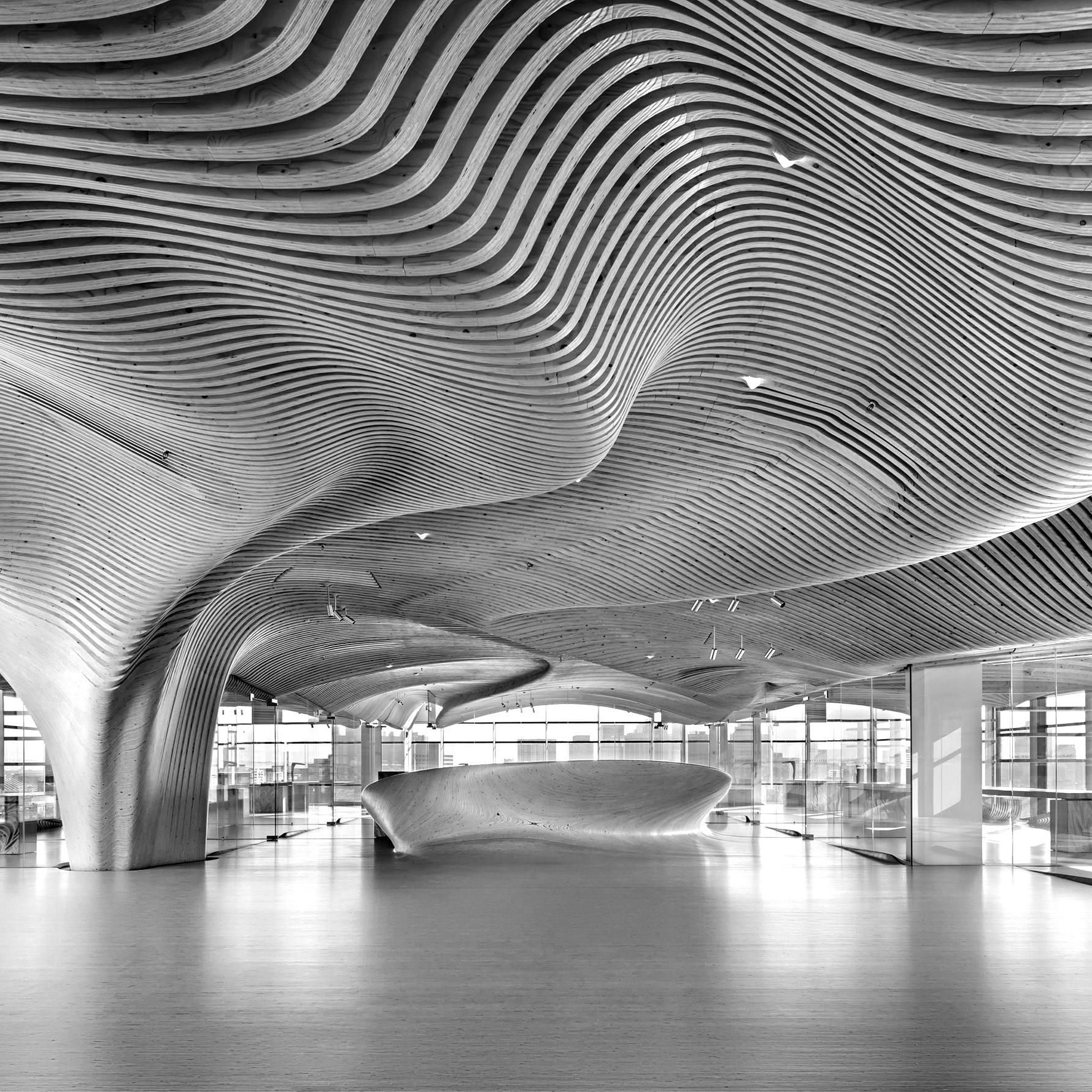 Curved-design-Metsa_Wood_One-Main-Boston-Office-Interior-blackwhite